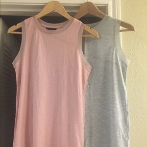 2 sleeveless shirts